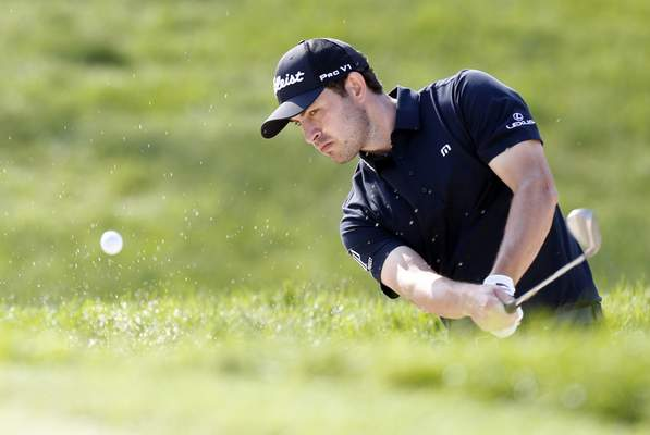 Associated Press Patrick Cantlay hits from the sand on the 18th hole during the final round of the Memorial on Sunday.