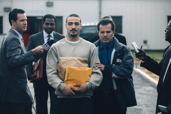"""Netflix Freddy Miyares, center, and John Leguizamo, right, star in the latest Netflix offering, """"When They See Us."""""""