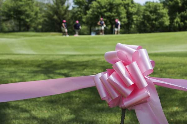 Pink ribbons line the roadside of the Sycamore Hills Golf Club on Monday for the Vera Bradley Classic golf tournament. (Photos by Mike Moore | The Journal Gazette)