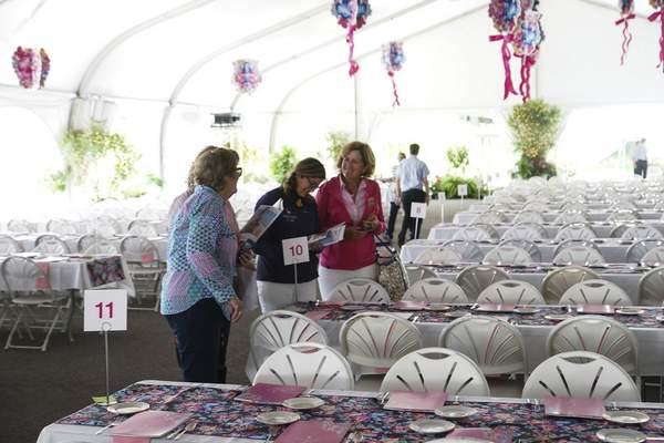 Guests get a sneak peek at the gala set up for the Vera Bradley Classic golf tournament on Monday to raise donations for breast cancer research at the Sycamore Hills Golf Club.