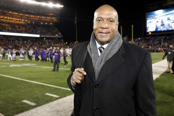 FILE - In this Dec. 27, 2015, file photo, Minnesota Vikings chief operating officer Kevin Warren poses for a photo before an NFL football game against the New York Giants, in Minneapolis. The Big Ten hired Minnesota Vikings executive Kevin Warren as its new commissioner Tuesday, June 4, 2019, bringing on a former college basketball player and sports agent with a law degree from Notre Dame to replace Jim Delany and become the first black commissioner of a Power Five conference. (AP Photo/Ann Heisenfelt, File)