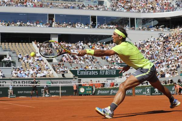 Spain's Rafael Nadal plays a shot against Argentina's Juan Ignacio Londero during their fourth round match of the French Open tennis tournament at the Roland Garros stadium in Paris, Sunday, June 2, 2019. (AP Photo/Michel Euler)