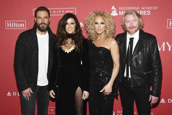 FILE - In this Jan. 26, 2018 file photo, Jimi Westbrook, from left, Karen Fairchild, Kimberly Schlapman and Phillip Sweet of Little Big Town arrive at the 2018 MusiCares Person of the Year tribute honoring Fleetwood Mac at the Radio City Music Hall in New York. (Photo by Charles Sykes/Invision/AP, File)