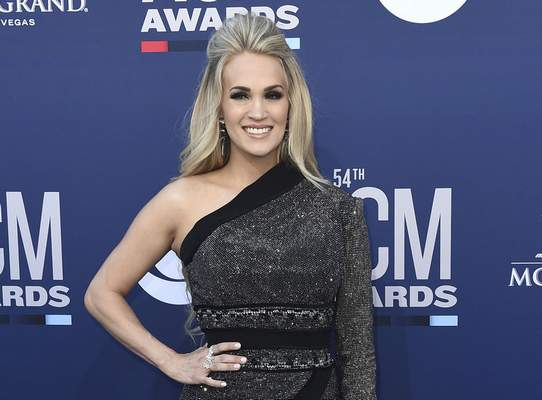 FILE - In this April 7, 2019 file photo Carrie Underwood poses at the 54th annual Academy of Country Music Awards in Las Vegas. (Photo by Jordan Strauss/Invision/AP, File)