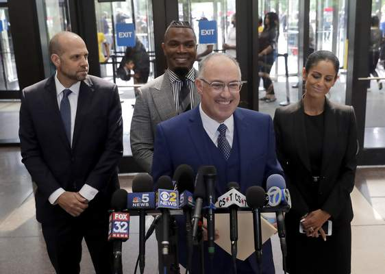 Steve Greenberg, R. Kelly's defense attorney, smiles as he responds to a question after Kelly pleaded not guilty on 11 new sex-related felonies Thursday, June 6, 2019, in Chicago. Thursday's hearing comes a week after prosecutors announced the new counts, including four of aggravated criminal sexual assault. (AP Photo/Charles Rex Arbogast)