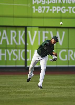 Katie Fyfe | The Journal Gazette TinCaps' outfielder Aldemar Burgos throws the ball back to the infield during the fourth inning against the Lake County Captains at Parkview Field on Thursday.