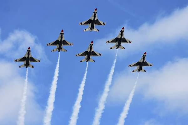 The U.S.& Air Force Thunderbirds fly over the Air National Guard's 122nd Fighter Wing on Thursday as they arrive for this weekend's Fort Wayne Air Show at the base. (Photos by Katie Fyfe | The Journal Gazette)
