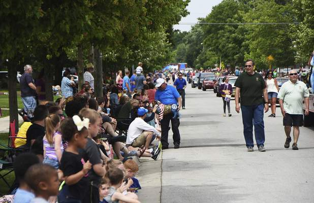 Katie Fyfe | The Journal Gazette  Residents line up along the Canal Days Parade route to watch the floats and performers pass by in New Haven on Saturday.