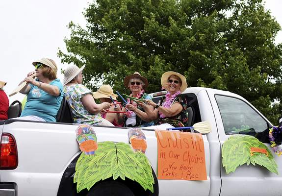 Katie Fyfe | The Journal Gazette  The New Haven Parks & Recreation crew cruises through the parade in their float for the Canal Days Parade in New Haven on Saturday.