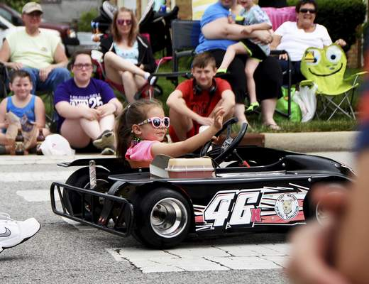 Katie Fyfe | The Journal Gazette  McKinlee Perkins, 5, cruises through the Canal Days Parade in New Haven on Saturday.