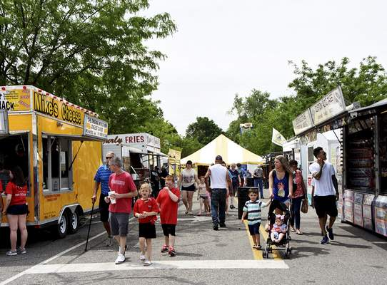 Katie Fyfe | The Journal Gazette  People walk along food stalls during the Canal Days Festival in New Haven on Saturday.