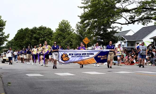 Katie Fyfe | The Journal Gazette  The New Haven High School Mighty Marching Bulldogs walk the Canal Days Parade in New Haven on Saturday.
