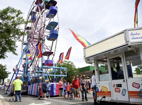 Katie Fyfe | The Journal Gazette  People attend the Canal Days Festival in New Haven on Saturday.