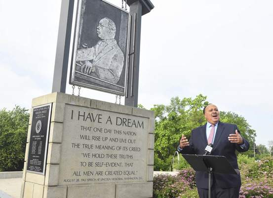 Michelle Davies | The Journal Gazette  Martin Luther King III spoke before placing a wreath at the bridge named for his father, the Rev. Martin Luther King Jr., Thursday morning. King spoke to his father's