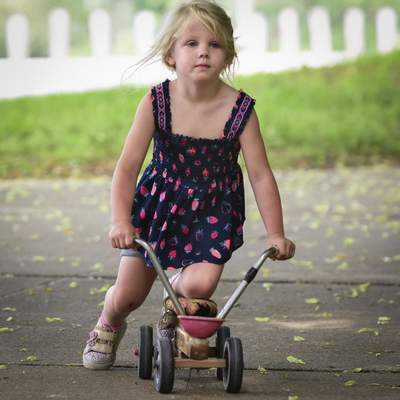 Mike Moore | The Journal Gazette  4-year-old Rue Orr rides a Radio Flyer scooter her grandfather fixed up for her at Lawton Park on Monday.