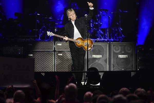 Mike Moore | The Journal Gazette  Paul McCartney plays to a sold-out crowdat Memorial Coliseum on Monday.