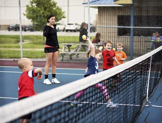 Katie Fyfe | The Journal Gazette  PeeWee Tennis is held at Jury Park in New Haven on Tuesday. The class is designed to introduce youth to the game of tennis in a fun and exciting way.