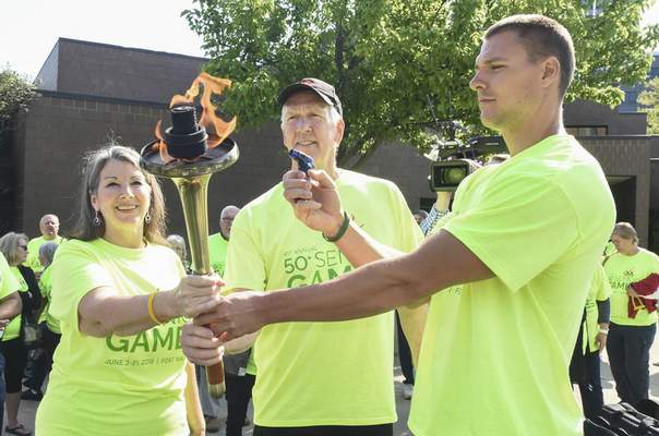 Michelle Davies | The Journal Gazette  Kicking off the start of the 2019 Senior Games are, from left, Holly Small, winner in 2018, Joe Sowder, winner in 2017, and Joel Bowerman, assistant manager at Fort Wayne Community Center. The games encompassthree weeks and 36 sports with participants who are 50+ years of age.