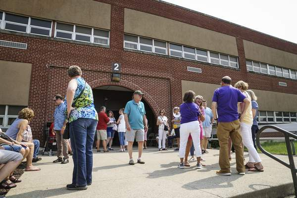 Mike Moore | The Journal Gazette  Guests gather outside the New Haven Middle School on Saturday to enjoy one last look at the iconic school before demolition began on Monday.
