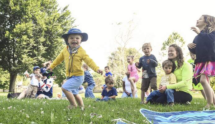 Michelle Davies | The Journal Gazette  Breck Glassburn, 2, of Fort Wayne, dances happily during storytime in Lawton Park Monday morning. Storytime on the Riverfront takes place Mondays in June, July and August, with the exception of July 16.