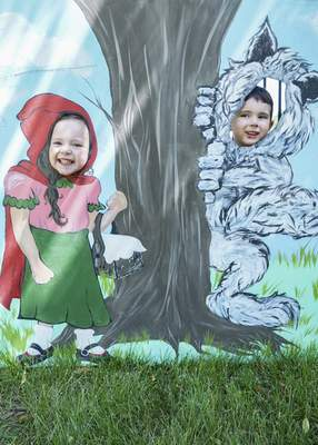 Mike Moore | The Journal Gazette  Four-year-old twins Harper Henry, left, and Finley Henry pose for a photo as Little Red Riding Hood and the Wolf during Germanfest at Headwaters Park on Friday.