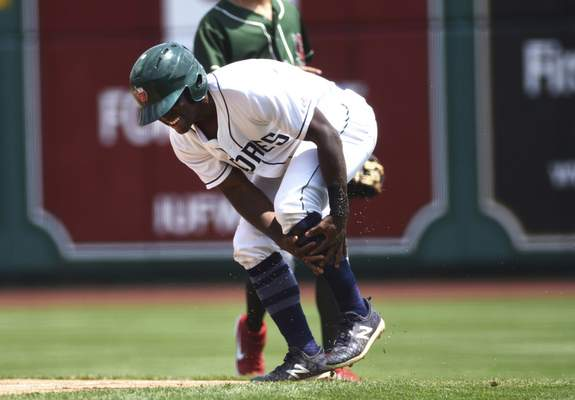 Katie Fyfe | The Journal Gazette TinCaps' Lee Solomon trips running to first base and hurts his leg during the first inning but is still able to play against the Great Lakes Loons at Parkview Field in Fort Wayne on Sunday.