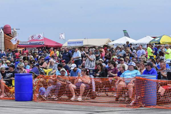 Mike Moore | The Journal Gazette Thousands of spectators watch the sky as planes from all eras fly over Fort Wayne during the Fort Wayne Air Show, presented by the 122nd Fighter Wing Air National Guard on Saturday.