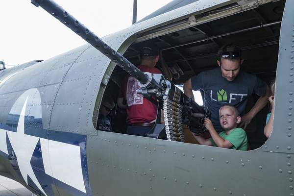Mike Moore | The Journal Gazette  Calvin Butler, 5, pretends to shoot down fighter planes from the waist gunner position of a WWII-era B-17 bomber during the Fort Wayne Air Show, presented by the 122nd Fighter Wing Air National Guard on Saturday.