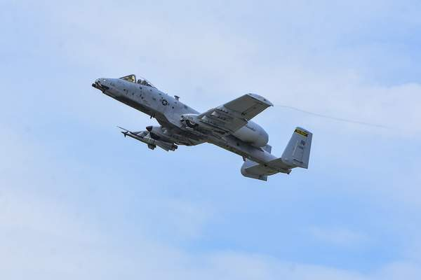 Mike Moore | The Journal Gazette  An A-10 Thunderbolt from the 122nd Fighter Wing Blacksnakes flies low to the ground for the Fort Wayne Air Show at Baer Field on Saturday.