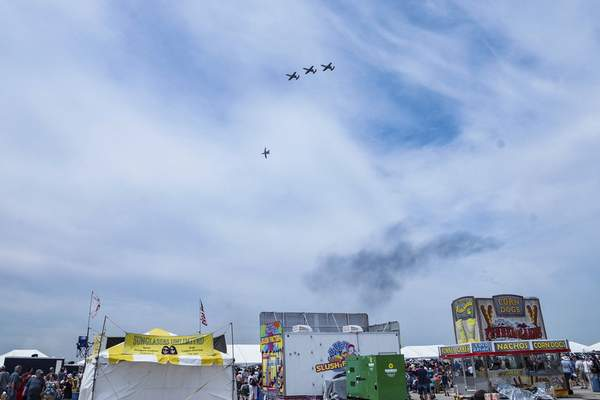 Mike Moore | The Journal Gazette  A formation of A-10 Thunderbolts from the 122nd Fighter Wing Blacksnakes fly low over the crowd attending the Fort Wayne Air Show at Baer Field on Saturday.