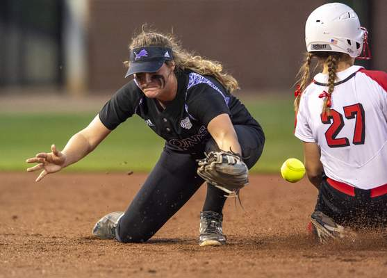 Doug McSchooler | Special to The Journal Gazette  Leo junior Kennedy Shade tries to make the catch and the tag on Center Grove freshman Sydney McConnell as she slides into second base in the Class 4A state title game at West Lafayette.
