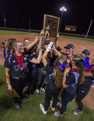 Doug McSchooler | Special to The Journal Gazette  The Leosoftball team reacts to theirrunner-up trophy afterthe state title gameagainst Center Grove in West Lafayette.