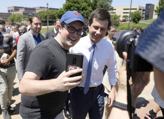 Associated Press Democratic presidential candidate Pete Buttigieg poses for a selfie Saturday during the Capital City Pride Fest in Des Moines, Iowa.
