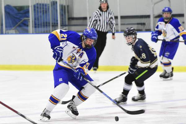 Photos by Mike Moore | The Journal Gazette Homestead's Carter Roach stick-handles against Bishop Dwenger in a 3-on-3 hockey game at SportONE/Parkview Icehouse.