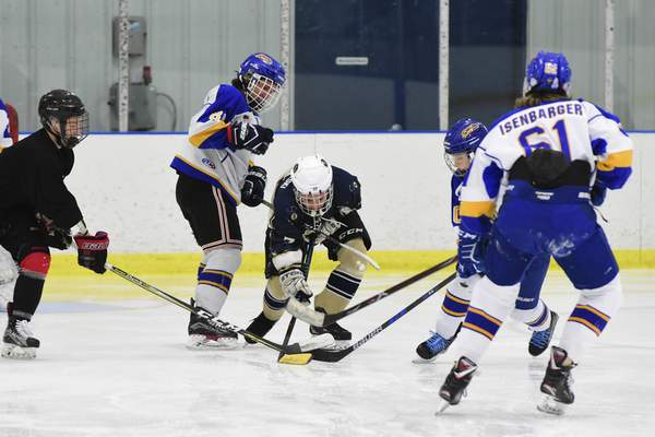 Mike Moore | The Journal Gazette  Homestead and Bishop Dwenger compete in 3-on-3 hockey at SportONE/Parkview Icehouse.