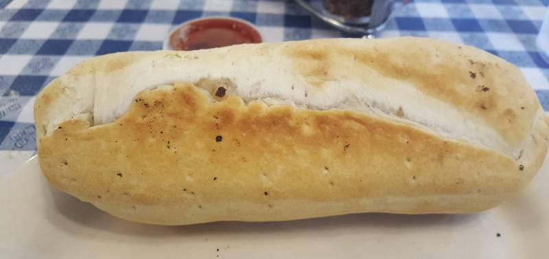 A small sausage roll from Oley's Pizza at Coliseum Boulevard and Lake Avenue.