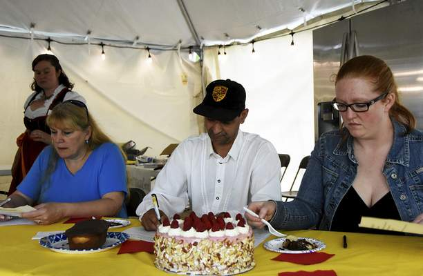 Katie Fyfe | The Journal Gazette  Judges Lisa Wolf, Chef Cornell Taubert, and Lindsay Miller taste the different German baked goods during the 18th annual Germanfest Bake Off at Headwaters Park on Sunday.