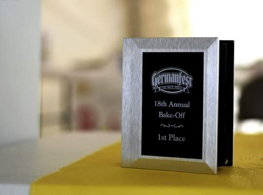 Katie Fyfe | The Journal Gazette  Recipe books and cash prizes are provided for bakers that place first through third place during the 18th annual Germanfest Bake Off at Headwaters Park on Sunday.