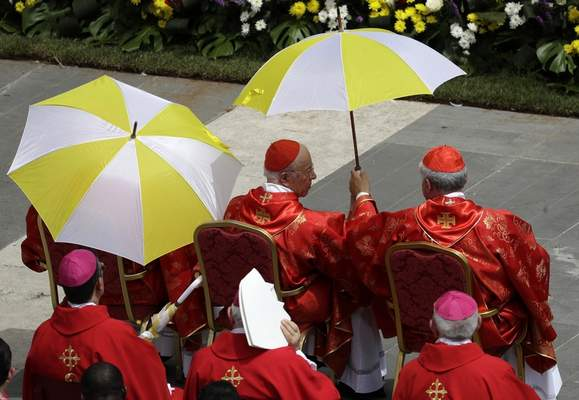 Cardinals shelter from the sun during a Pentecost Mass celebrated by Pope Francis in St. Peter's Square, at the Vatican, Sunday, June 9, 2019. (AP Photo/Gregorio Borgia)