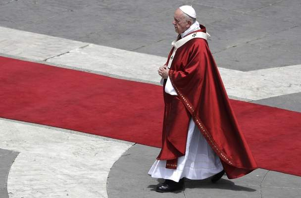 Pope Francis walks after celebrating a Pentecost Mass in St. Peter's Square, at the Vatican, Sunday, June 9, 2019. The Pentecost Mass is celebrated on the seventh Sunday after Easter. (AP Photo/Gregorio Borgia)