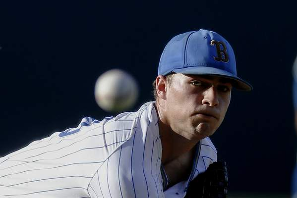UCLA's Nick Nastrini (30) throws to a Michigan batter during the first inning of an NCAA college baseball tournament super regional game in Los Angeles, Sunday, June 9, 2019. (AP Photo/Ringo H.W. Chiu)