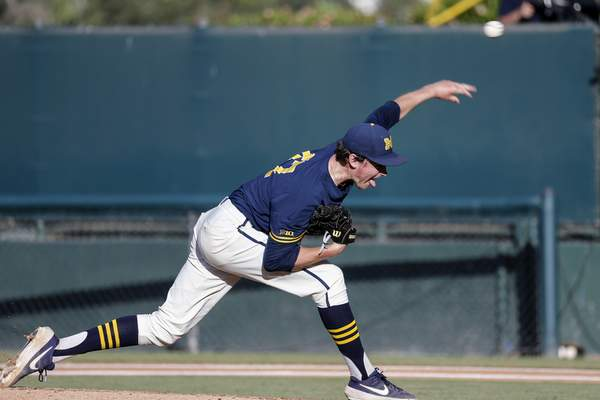 Michigan's Tommy Henry (47) throws to a UCLA batter during the first inning of an NCAA college baseball tournament super regional game in Los Angeles, Sunday, June 9, 2019. (AP Photo/Ringo H.W. Chiu)
