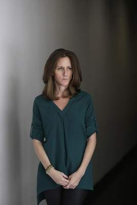 Kim Goldman poses for a portrait Friday, June 7, 2019, in Los Angeles. Goldman has continued to make the case publicly that it was O.J. Simpson who killed her brother and Simpson's ex-wife on a June night in 1994. Beginning Wednesday, Goldman will examine the case in a 10-episode podcast, Confronting: OJ Simpson. (AP Photo/Marcio Jose Sanchez)