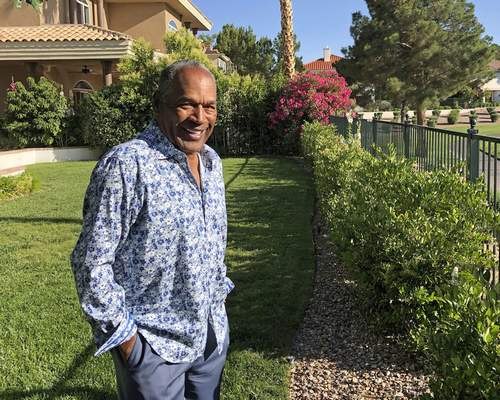 This photo provided by Didier J. Fabien shows O.J. Simpson in the garden of his Las Vegas area home on Monday, June 3, 2019. (Didier J. Fabien via AP)