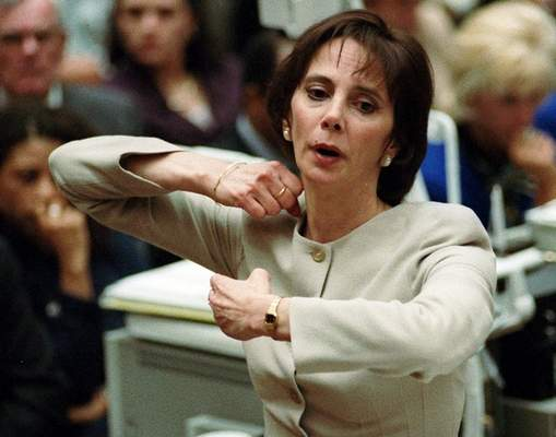 FILE - In this Sept. 26, 1995, file photo, prosecutor Marcia Clark demonstrates to the jury how the murders of Nicole Brown Simpson and Ron Goldman were committed during her closing arguments in the O.J. Simpson double-murder trial in Los Angeles. (Myung J. Chun/Los Angeles Daily News via AP, Pool, File)