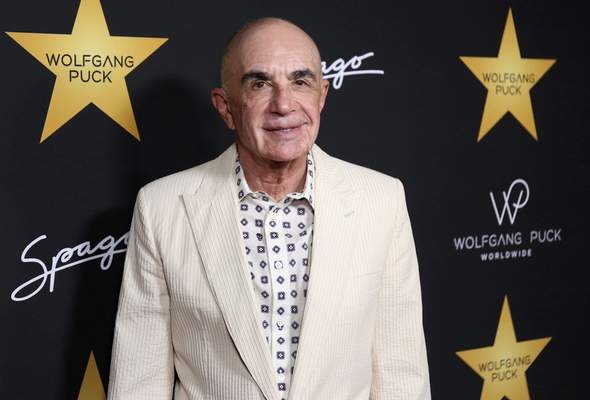 FILE - in this April 26, 2017, file photo, Robert Shapiro arrives at Wolfgang Puck's Post-Hollywood Walk of Fame Star Ceremony Celebration at Spago in Beverly Hills, Calif. Shapiro, the first member of Simpson's defense team, continues to practice law.  (Photo by Willy Sanjuan/Invision/AP, File)