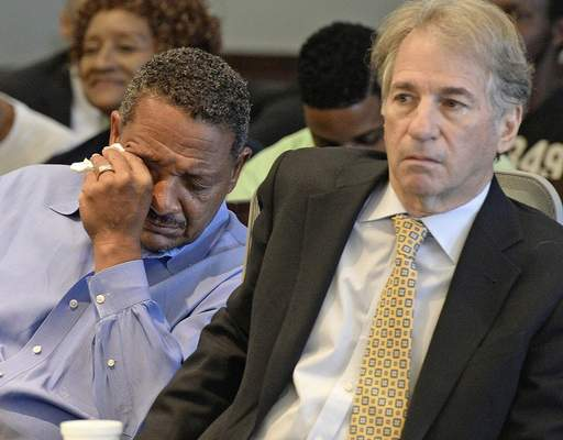 FILE - In this Aug. 31, 2016, file photo, Darryl Howard wipes away tears as he and his lawyer, Barry Scheck, co-director of the based Innocence Project, listen as Judge Orlando Hudson threw out Howard's double-murder conviction after reviewing new DNA evidence, in Durham, N.C. Scheck was the lawyer who introduced DNA science to jurors as he attacked police methods of evidence collection to undermine the prosecution's forensic evidence case. (Chuck Liddy/The News & Observer via AP, File)