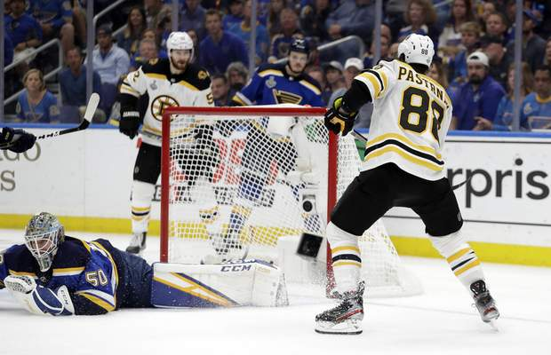 Associated Press Bruins right wing David Pastrnak scores a goal against Blues goaltender Jordan Binnington during the third period Sunday of Game 6 of the Stanley Cup Final, a game Boston won 5-1.