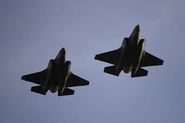 Associated Press photos U.S. Air Force F-35A fighter jets fly over Levi's Stadium before an NFL football game in November 2018. United Technologies makes engines for Lockheed Martin Corp.'s F-35 stealth fighter.