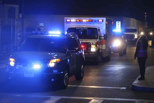 An ambulance carrying David Ortiz is escorted to Mass General Hospital in Boston Monday night, June 10, 2019. Ortiz was back in Boston on Monday night for medical care, a day after authorities said the former Red Sox slugger affectionately known as Big Papi was ambushed by a gunman at a bar in his native Dominican Republic. (Nathan Klima/The Boston Globe via AP)